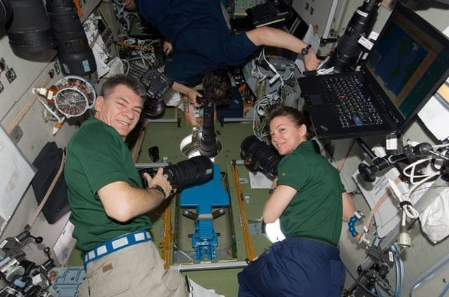 Astronauts work in international space station