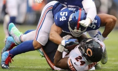 EAST RUTHERFORD, NEW JERSEY - DECEMBER 02: Jordan Howard #24 of the Chicago Bears is tackled by Olivier Vernon #54 of the New York Giants in the first half at MetLife Stadium on December 02, 2018 in East Rutherford, New Jersey. (Photo by Elsa/Getty Images)
