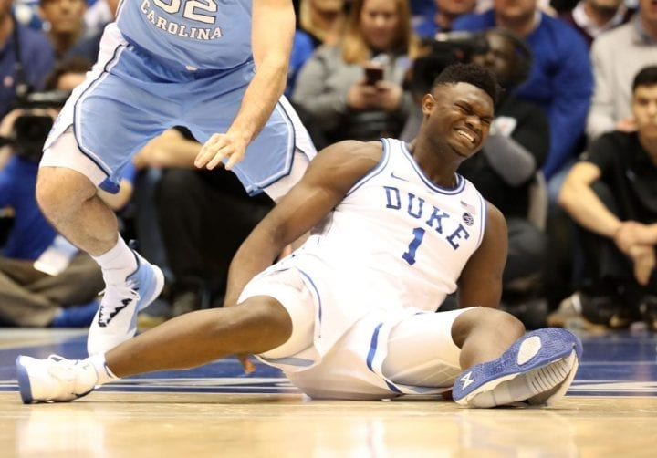 DURHAM, NORTH CAROLINA - FEBRUARY 20: (EDITORS NOTE: Retransmission with alternate crop.) Zion Williamson #1 of the Duke Blue Devils reacts after falling as his shoe breaks in the first half of the game against the North Carolina Tar Heels at Cameron Indoor Stadium on February 20, 2019 in Durham, North Carolina. (Photo by Streeter Lecka/Getty Images)