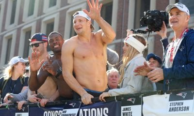 BOSTON, MASSACHUSETTS - FEBRUARY 05: Rob Gronkowski #87 of the New England Patriots celebrates on Cambridge street during the New England Patriots Victory Parade on February 05, 2019 in Boston, Massachusetts. (Photo by Maddie Meyer/Getty Images)