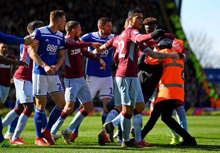 BIRMINGHAM, ENGLAND - MARCH 10: A fan is wrestled to the ground by a steward after punching Jack Grealish of Aston Villa during the Sky Bet Championship match between Birmingham City and Aston Villa at St Andrew's Trillion Trophy Stadium on March 10, 2019 in Birmingham, England. (Photo by Alex Davidson/Getty Images)