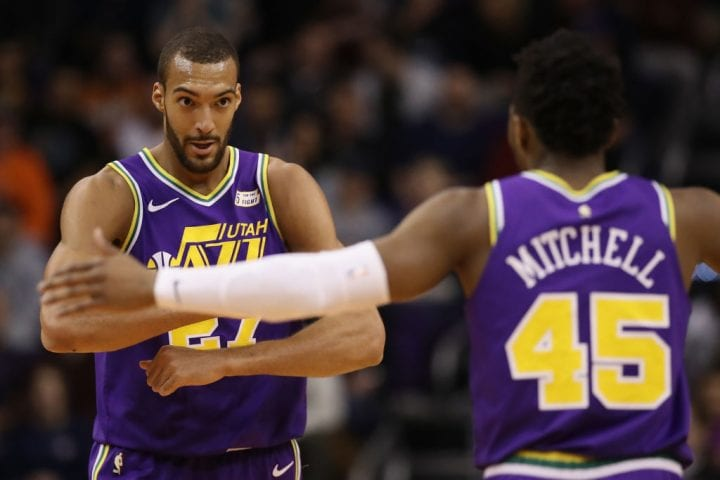 PHOENIX, ARIZONA - MARCH 13: Rudy Gobert #27 of the Utah Jazz is congratulated by Donovan Mitchell #45 after scoring against the Phoenix Suns during the first half of the NBA game at Talking Stick Resort Arena on March 13, 2019 in Phoenix, Arizona. (Photo by Christian Petersen/Getty Images)