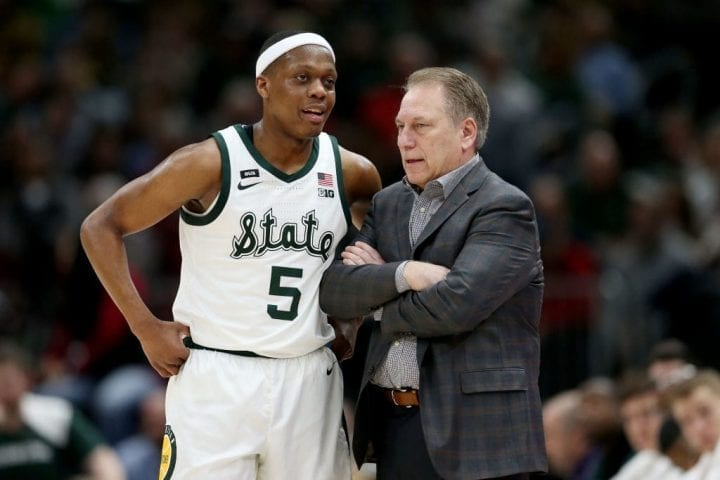 CHICAGO, ILLINOIS - MARCH 16: Cassius Winston #5 of the Michigan State Spartans meets with head coach Tom Izzo in the first half against the Wisconsin Badgers during the semifinals of the Big Ten Basketball Tournament at the United Center on March 16, 2019 in Chicago, Illinois. (Photo by Dylan Buell/Getty Images)