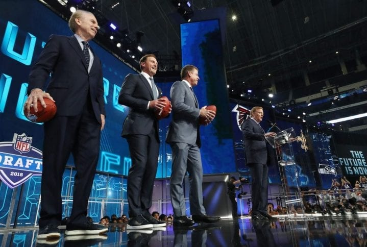 ARLINGTON, TX - APRIL 26: NFL Commissioner Roger Goodell stands onstage with Troy Aikman, Jason Witten, and Roger Staubach during the first round of the 2018 NFL Draft at AT&T Stadium on April 26, 2018 in Arlington, Texas. (Photo by Ronald Martinez/Getty Images)