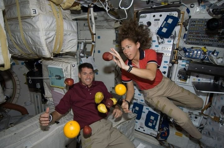 Astronauts floating fruit space zero gravity