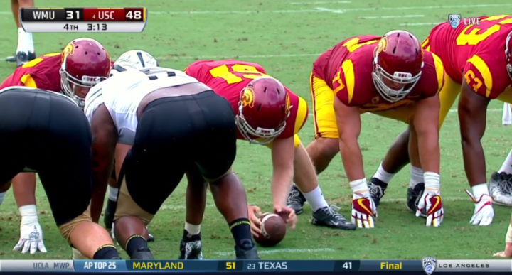 Jake Olson taking a snap for the USC Trojans