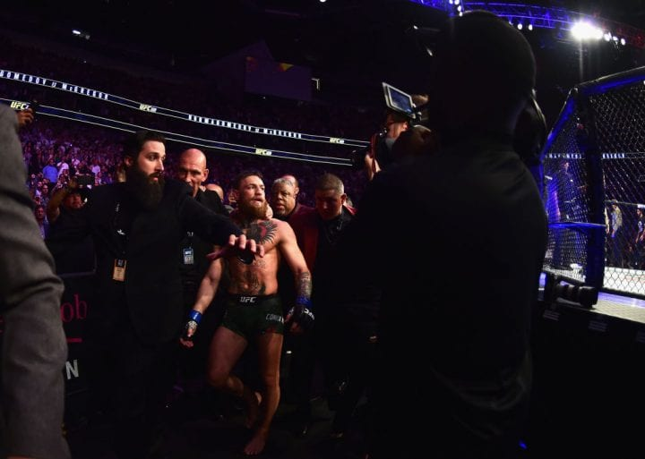 LAS VEGAS, NV - OCTOBER 06: Conor McGregor of Ireland is escorted out of the octagon after being defeated by Khabib Nurmagomedov of Russia in their UFC lightweight championship bout during the UFC 229 event inside T-Mobile Arena on October 6, 2018 in Las Vegas, Nevada. (Photo by Harry How/Getty Images)