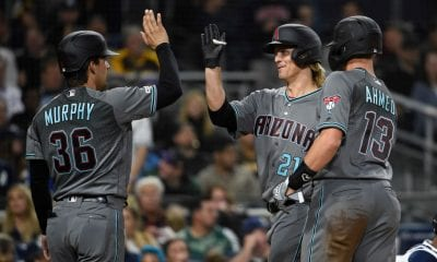 SAN DIEGO, CA - APRIL 2: Zack Greinke #21 of the Arizona Diamondbacks is congratulated by Nick Ahmed #13 and John Ryan Murphy #36 after hitting a three-run home run during the fourth inning of a baseball game against the San Diego Padres at Petco Park April 2, 2019 in San Diego, California. (Photo by Denis Poroy/Getty Images)