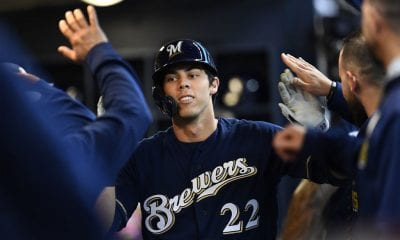 MILWAUKEE, WISCONSIN - MARCH 30: Christian Yelich #22 of the Milwaukee Brewers is congratulated by teammates following a home run against the St. Louis Cardinals during the first inning of a game at Miller Park on March 30, 2019 in Milwaukee, Wisconsin. (Photo by Stacy Revere/Getty Images)