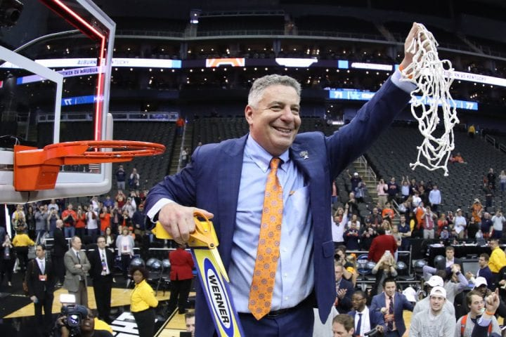 KANSAS CITY, MISSOURI - MARCH 31: Head coach Bruce Pearl of the Auburn Tigers celebrates by cutting down the nets after their 77-71 win over the Kentucky Wildcats in the 2019 NCAA Basketball Tournament Midwest Regional at Sprint Center on March 31, 2019 in Kansas City, Missouri. (Photo by Jamie Squire/Getty Images)