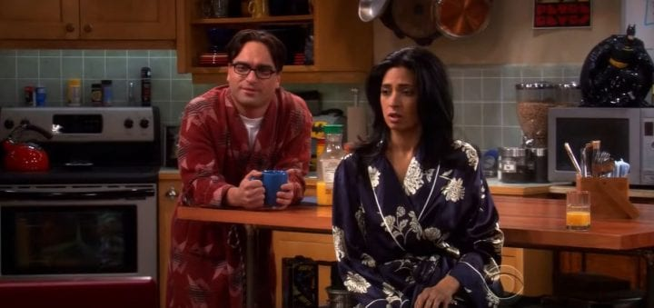 two people in a kitchen while in their robes