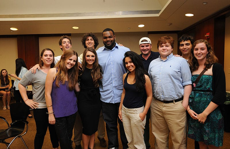 Michael Oher poses for a group photo