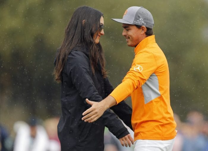 Allison Stokke and Rickie Fowler hug at a PGA Tour event