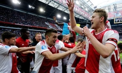 AMSTERDAM, NETHERLANDS - MAY 12: Klaas Jan Huntelaar of Ajax, Dusan Tadic of Ajax, Matthijs de Ligt of Ajax celebrates the victory during the Dutch Eredivisie match between Ajax v FC Utrecht at the Johan Cruijff Arena on May 12, 2019 in Amsterdam Netherlands (Photo by Soccrates/Getty Images)