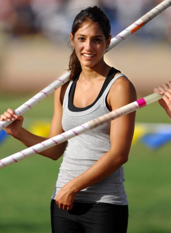 Allison Stokke smiles for a photo before she prepares for her next pole vault