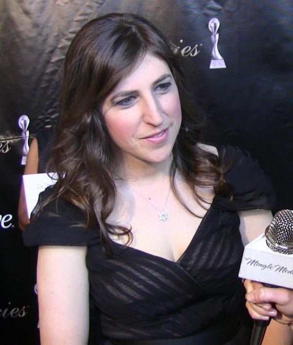 woman in a black dress in an interview