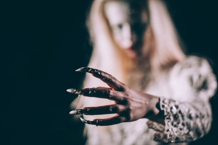 Scary witch lady long fingernails death