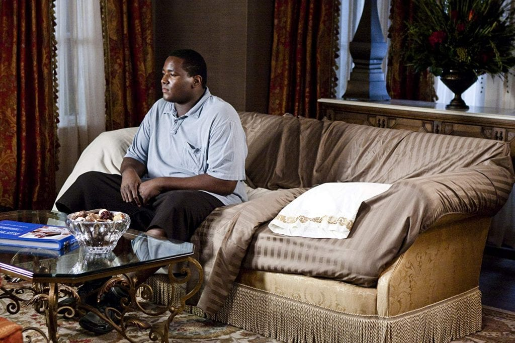 Michael Oher sits in his family's house