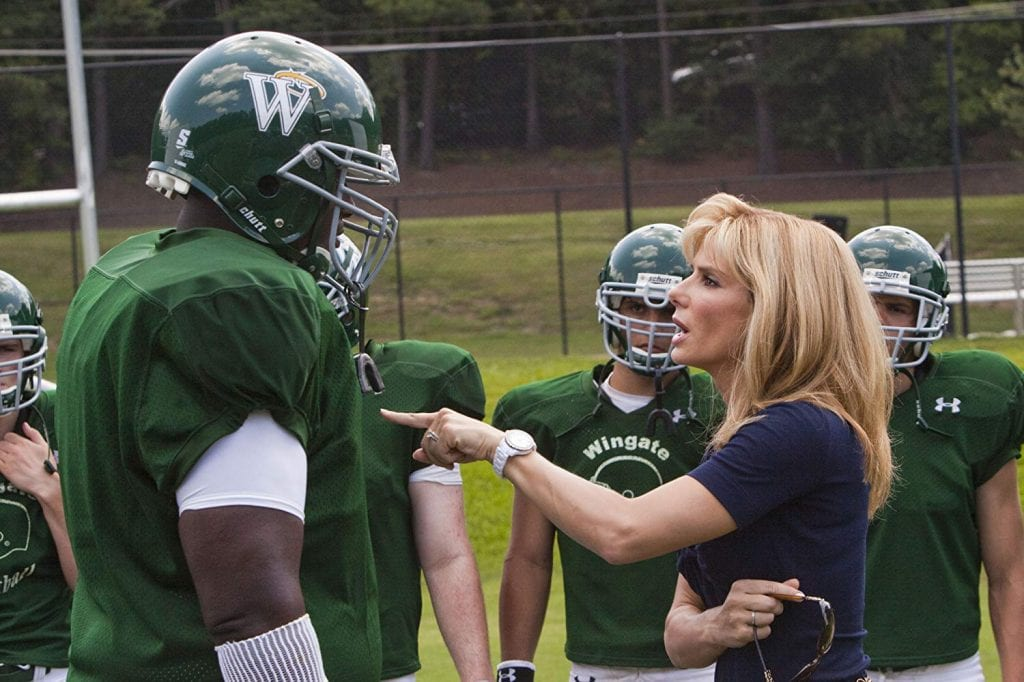 Sandra Bullock, playing Michael Oher's mom, coaches her son on the football field