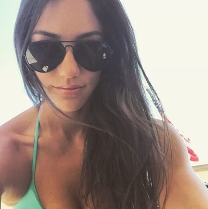 Allison Stokke poses for a photo