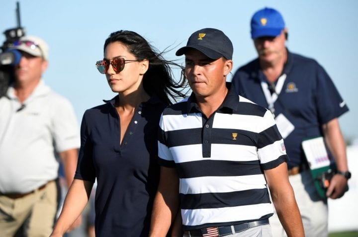 Rickie Fowler walks with his girlfriend, Allison Stokke, at a PGA Tour event