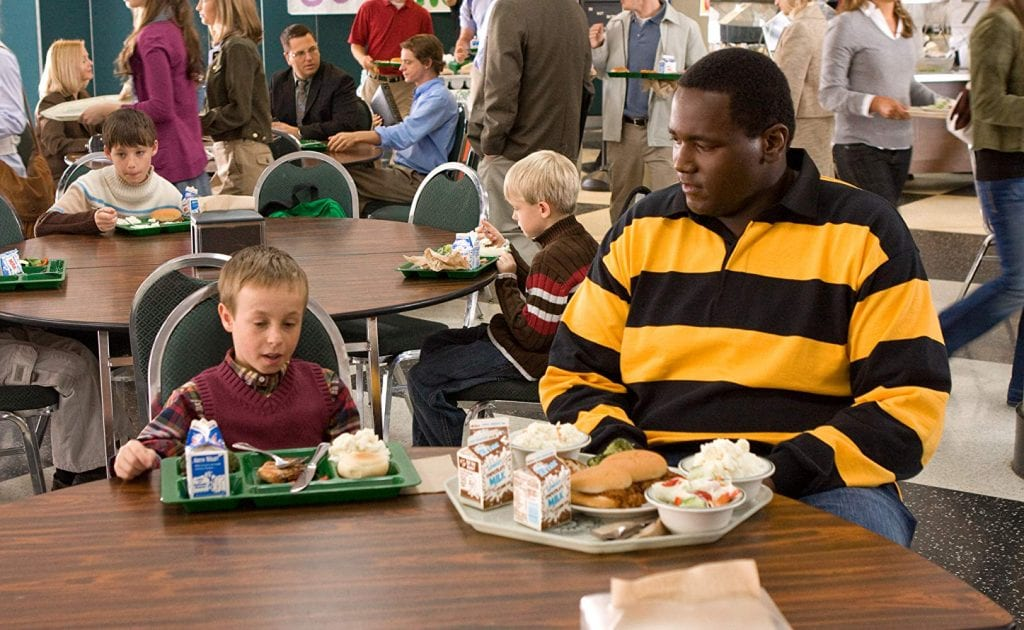 "S.J. Tuohy and Michael Oher in ""The Blind Side"""