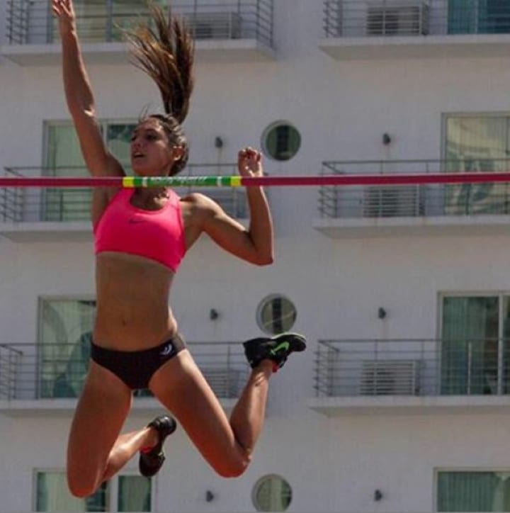 Allison Stokke attempts to clear the bar
