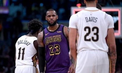 LeBron James #23 of the Los Angeles Lakers reacts in front of Anthony Davis #23 of the New Orleans Pelicans