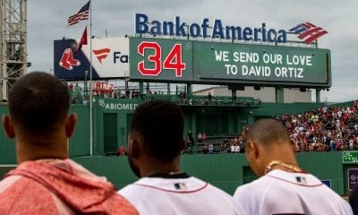 A moment of reflection is held as a message is displayed on the scoreboard for former designated hitter David Ortiz of the Boston Red Sox before a game against the Texas Rangers