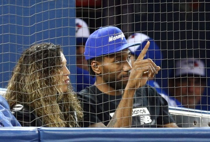 Kawhi Leonard of the Toronto Raptors acknowledges the crowd as he watches a MLB game between the Los Angeles Angels of Anaheim and the Toronto Blue Jays