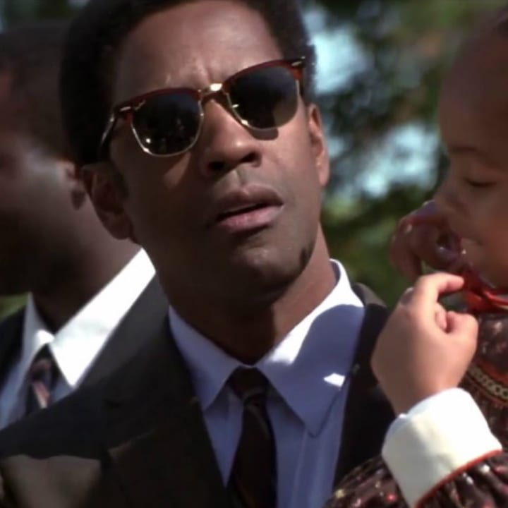 Denzel Washington as Coach Boone