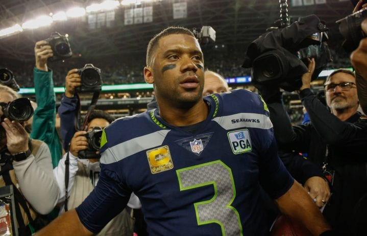 Quarterback Russell Wilson #3 of the Seattle Seahawks heads off the field