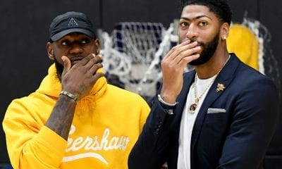 Anthony Davis (R) talks with LeBron James as Davis is introduced as the newest player of the Los Angeles Lakers