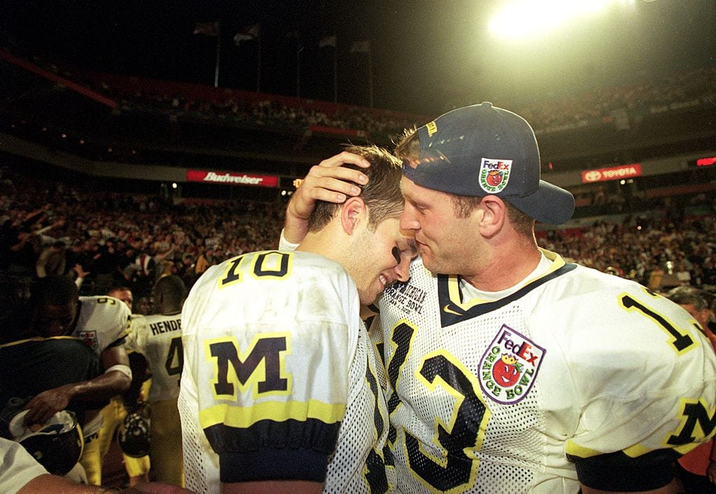 Tom Bradly and Jason Kapner of the Michigan Wolverines celebrate after winning the Orange Bowl Game against the Alabama Crimson Tide at the Pro Player Stadium in Miami, Florida. The Wolverines defeated the Crimson Tide 35-34