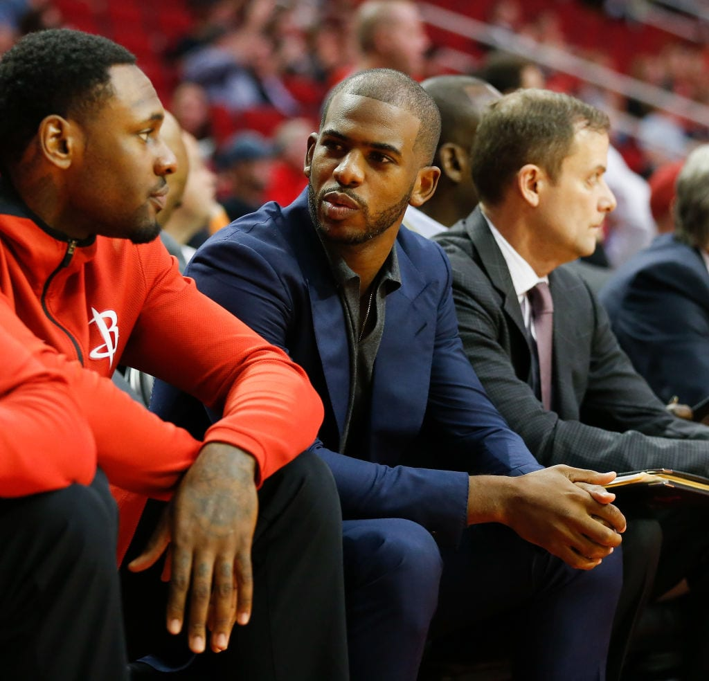 Chris Paul of the Houston Rockets sits on the bench at Toyota Center on October 23, 2017 in Houston, Texas. Paul is out with a knee injury.