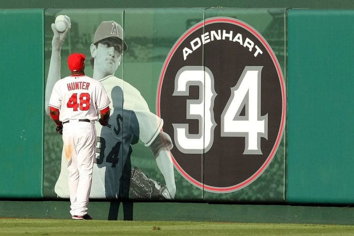Torii Hunter #48 of the Los Angeles Angels of Anaheim looks up at the Nick Adenhart display during the game against the New York Yankees