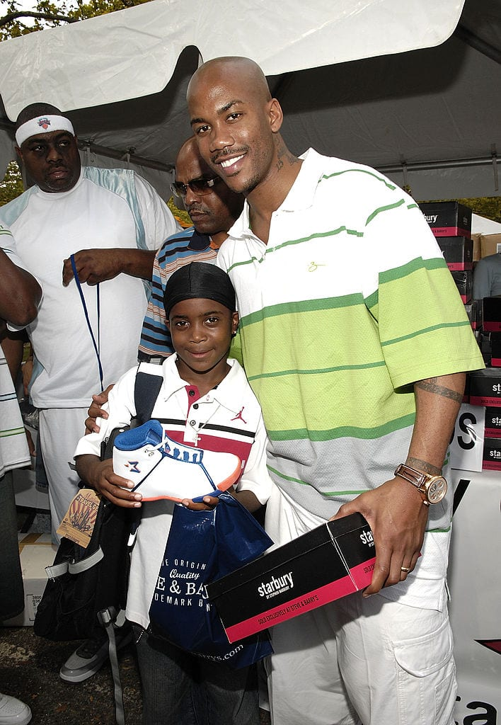 Pro Basketball Player Stephon Marbury(R) with Jahsiyh, giving away his Starbury Sneakers at The New York Call and Youth Xplosion - Starbury Giveback Day