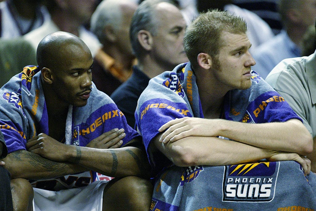 Stephon Marbury #3 and Jake Voskuhl #43 of the Phoenix Suns look on in Game 6 of the Western Conference Quarterfinals against the San Antonio Spurs during the 2003 NBA Playoffs