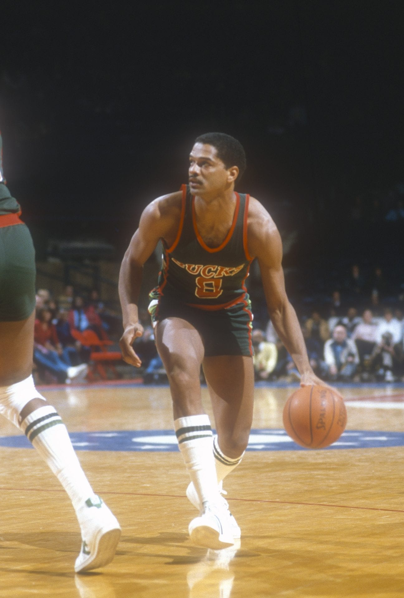 Marques Johnson #8 of the Milwaukee Bucks dribbles the ball against the Washington Bullets during an NBA basketball game circa 1983 at the Capital Centre in Landover, Maryland. Johnson played for the Bucks from 1977-85