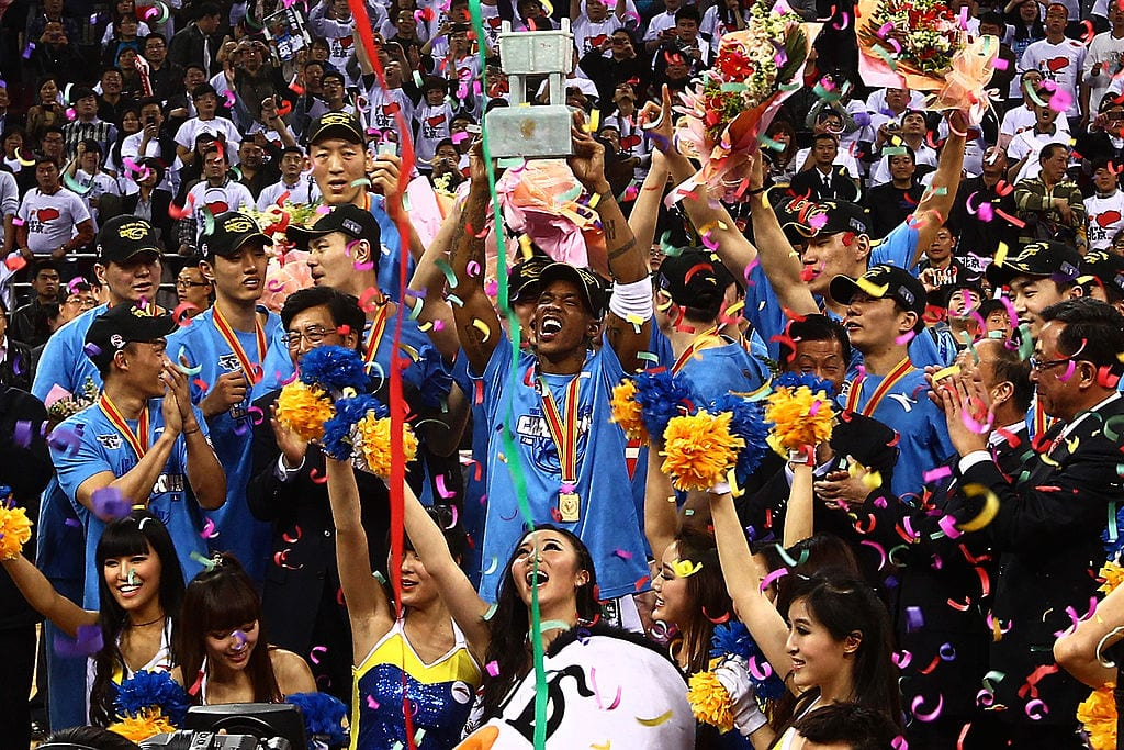 Stephon Marbury of the Beijing Ducks holds up the trophy after winning Game 5 the 2012 CBA Championship Finals against the Guangdong Southern Tigers