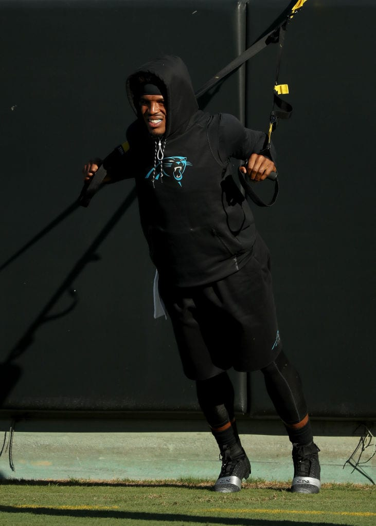 Cam Newton #1 of the Carolina Panthers warms up for their game against the New England Patriots at Bank of America Stadium