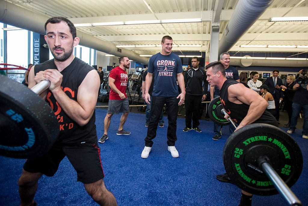 New England Patriots player Rob Gronkowski, center, encourages participants during the first work out in the Gronk Zone at Boston Sports Club