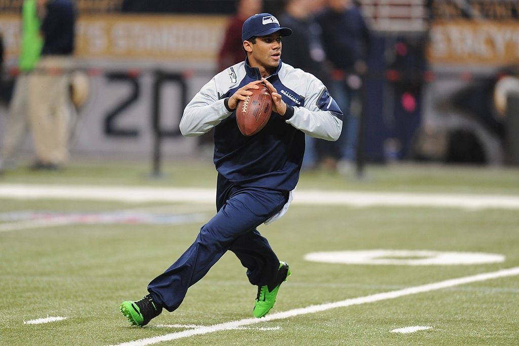 Russell Wilson #3 of the Seattle Seahawks warms up before a game against the St. Louis Rams at the Edward Jones