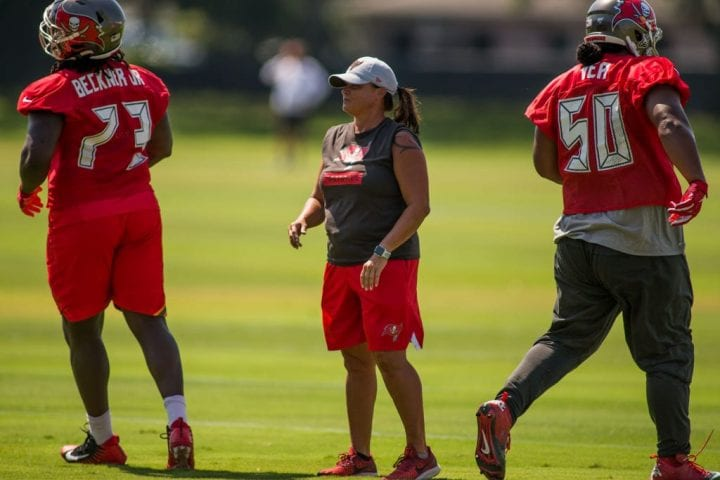 Assistant Defensive Line Coach Lori Locust looks on during OTA's with the Tampa Bay Buccaneers
