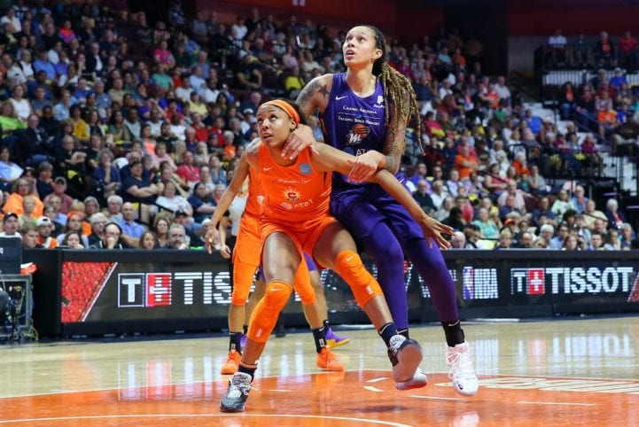 Phoenix Mercury center Brittney Griner (42) and Connecticut Sun center Kristine Anigwe (31) battles for position