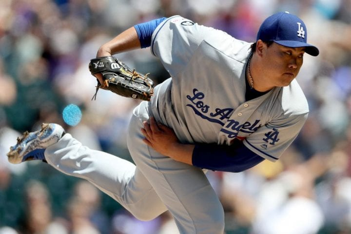Starting pitcher Hyun-Jin Ryu #99 of the Los Angeles Dodgers throws against the Colorado Rockies
