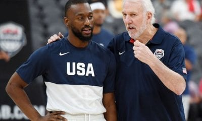 Kemba Walker (L) #26 of the 2019 USA Men's National Team talks with head coach Gregg Popovich
