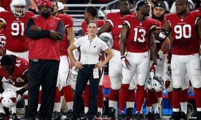 Intern linebacker coach Jen Welter (C) of the Arizona Cardinals watches from the sidelines