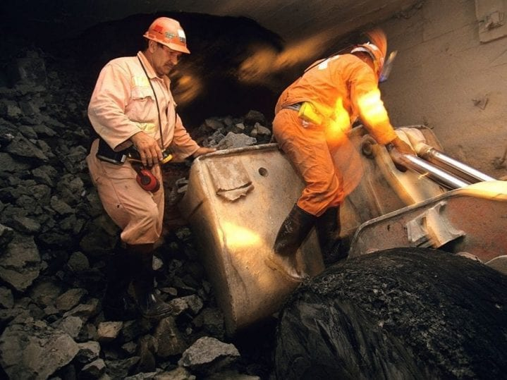 Miners in a diamond mine