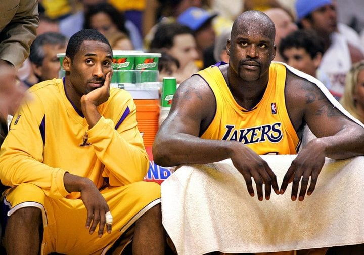 Lakers Kobe Bryant and Shaquille O'Neal sit on the bench with foul trouble